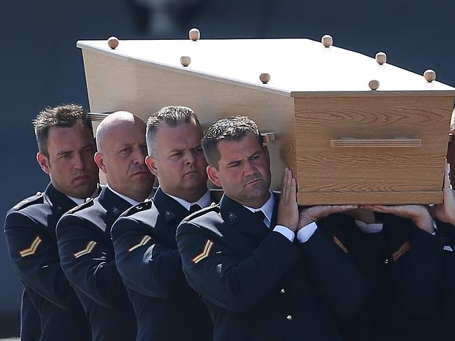 Dutch military personnel carry a coffin at Eindhoven airport on the national day of mourning for victims of Malaysian Airlines flight MH17.