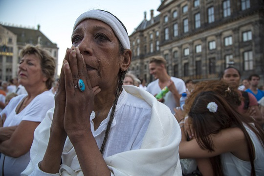People pay their respects during a national day of mourning for the victims killed in Malaysia Airlines flight MH17 disaster, in Amsterdam yesterday.