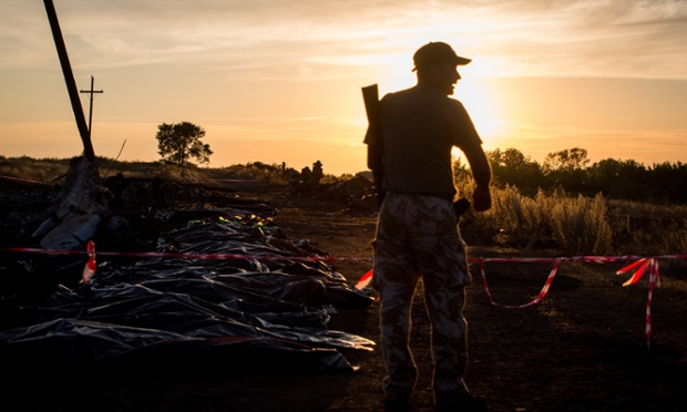 A Russia-backed separatist enters the MH17 crash site in the village of Grabovo, Donetsk Region, East Ukraine.