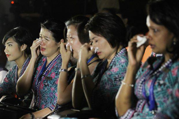 Loss and grief: Malaysia Airlines crew members reacting while watching a video tribute during the multi-faith prayer service at the Malaysia Airlines Academy in Kelana Jaya.