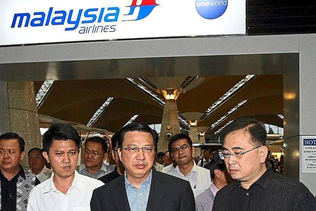 Back home: Liow being accompanied by Minister in the Prime Minister's Department, Datuk Dr Wee Ka Siong (right) and MCA Youth Chief Senator Chong Sin Woon upon his arrival at KLIA.