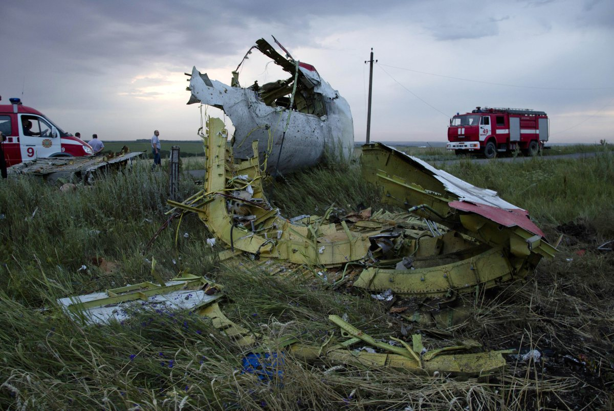 Firefighters arrive at the crash site of Malaysia Airlines Flight 17 near the village of Hrabove, Ukraine, on July 17, 2014.