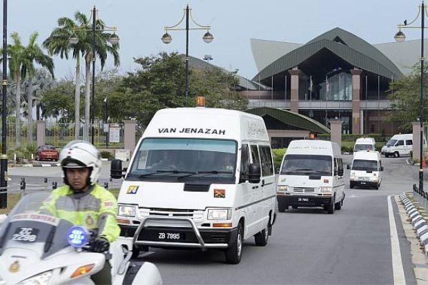 Hearses emerging from the Bunga Raya Complex at the Kuala Lumpur International Airport.
