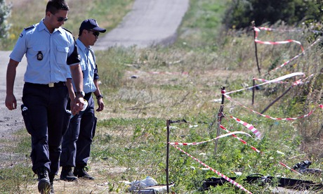 Australian and Dutch investigators examine a site close to where Malaysia Airlines flight MH17 crashed, near the village of Hrabove, eastern Ukraine