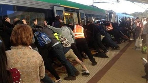 The staff organised the crowd to tilt the train backwards.
