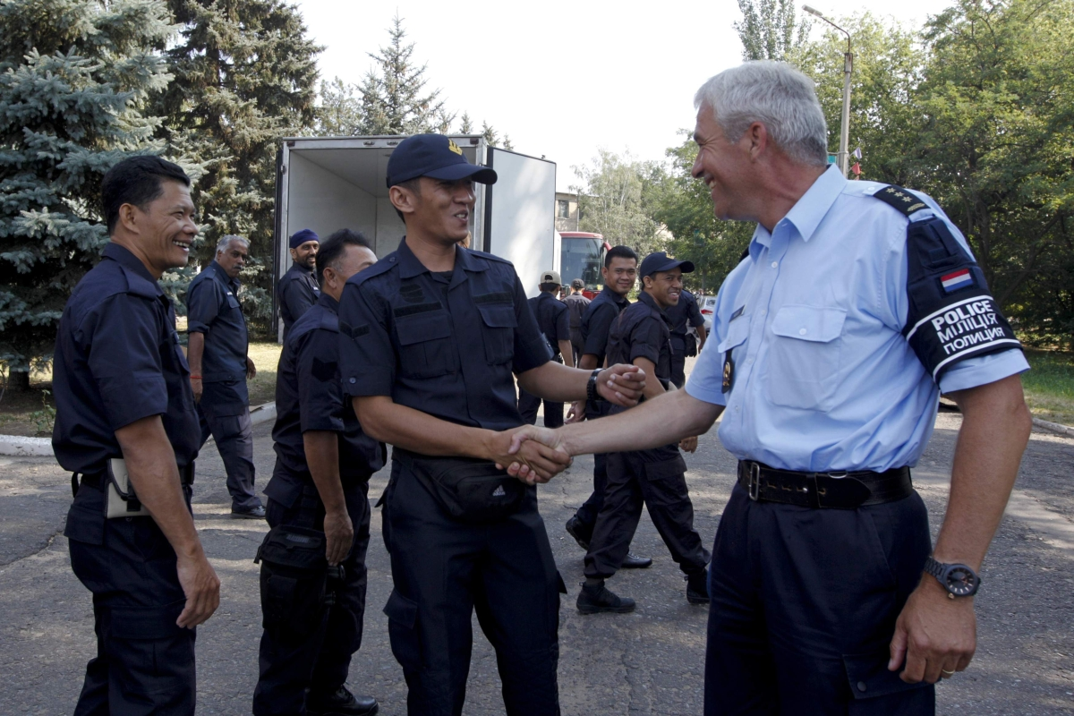 The Malaysian team greeted by Dutch colonel Cornelis Kuijs (right), the commander of a group of international experts investigating the MH17 crash site, at the eastern Ukrainian town of Soledar, yesterday.