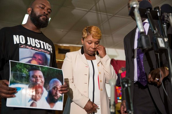 Michael Brown Sr. and Lesley McSpadden, while mourning their son, asked supporters to remain peaceful.