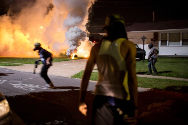 Demonstrators and journalists ran from tear gas fired by the police in Ferguson, Mo., on Wednesday.