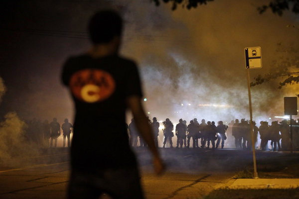 Police walked through a cloud of smoke during a clash with protesters on Wednesday in Ferguson
