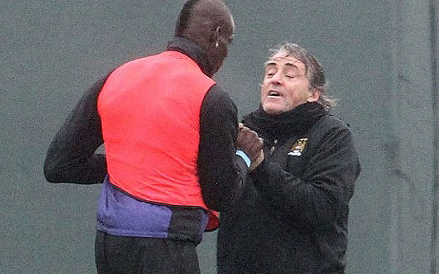 Balotelli in a bust up fight with then Manchester City manager Roberto Mancini.