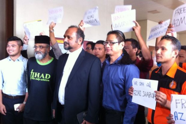 Azmi (in blue) with his lawyer Gobind Singh (third right) outside the courtroom. Also present were students and UM lecturers showing their solidarity.