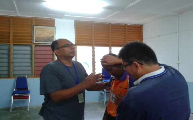 Bobby John (left) praying performing a prayer in one of the rehab centre.