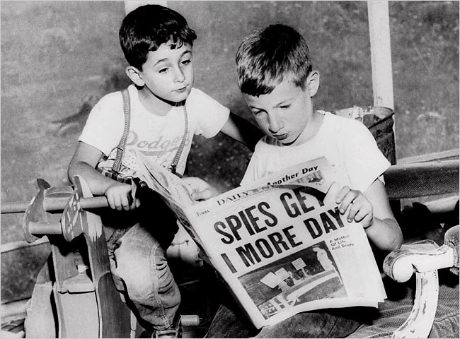 Ethel and Julius Rosenberg's sons, Robert, 6, left, and Michael, 10, looking at a 1953 newspaper. They still believe their parents did not deserve to die.