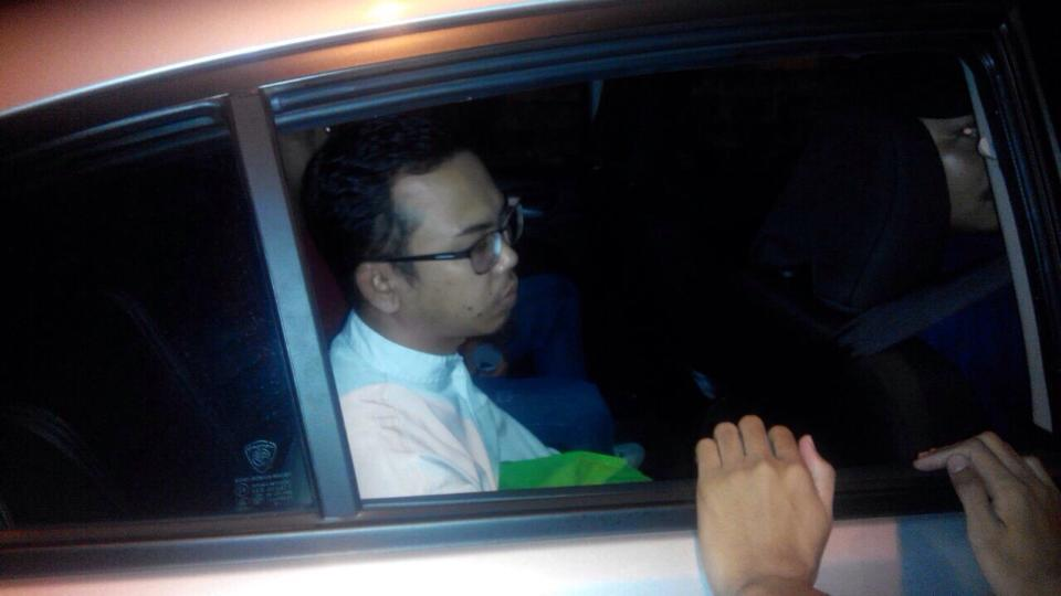 Wan Ji Wan Husin being brought to the police station in this Facebook picture posted early this morning.