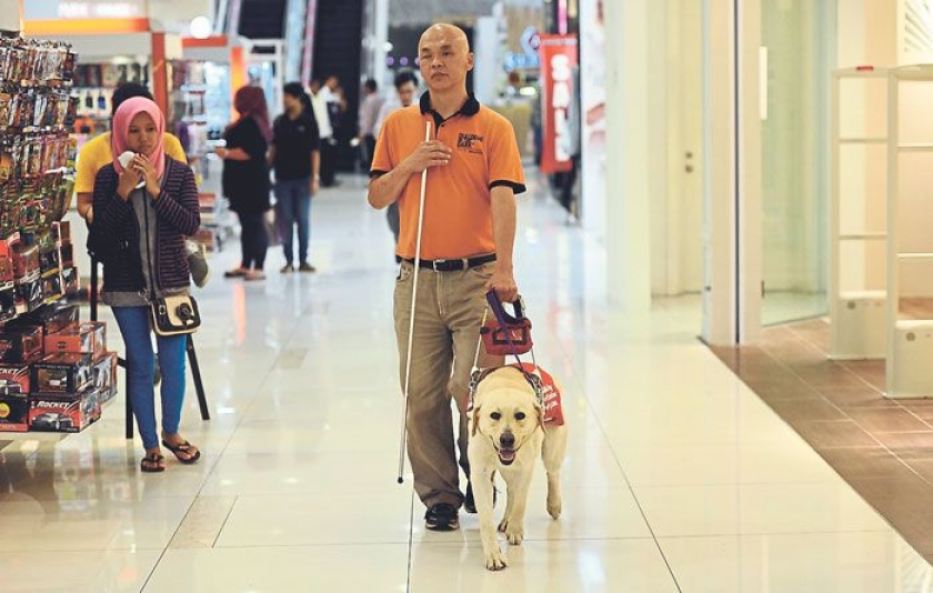 Stevens Chan with his guide dog, who is also Malaysia's first guide dog.