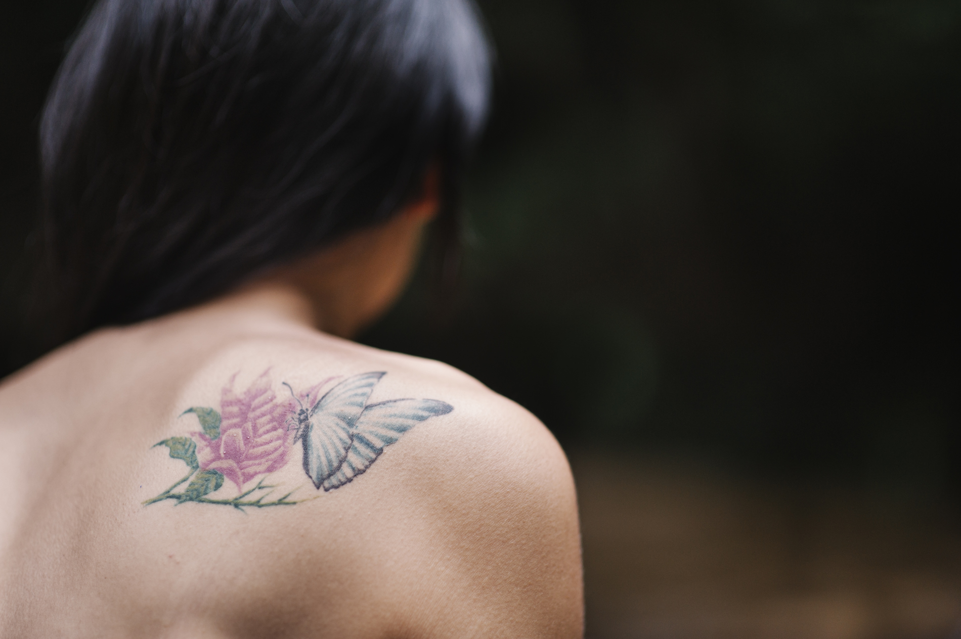"""""""Jina,"""" a 22-year-old transgender woman, sports a tattoo of a butterfly—a transgender symbol signifying transformation: """"There's a lot of politicization of the LGBT community at the moment, to distract the public from more important issues."""""""