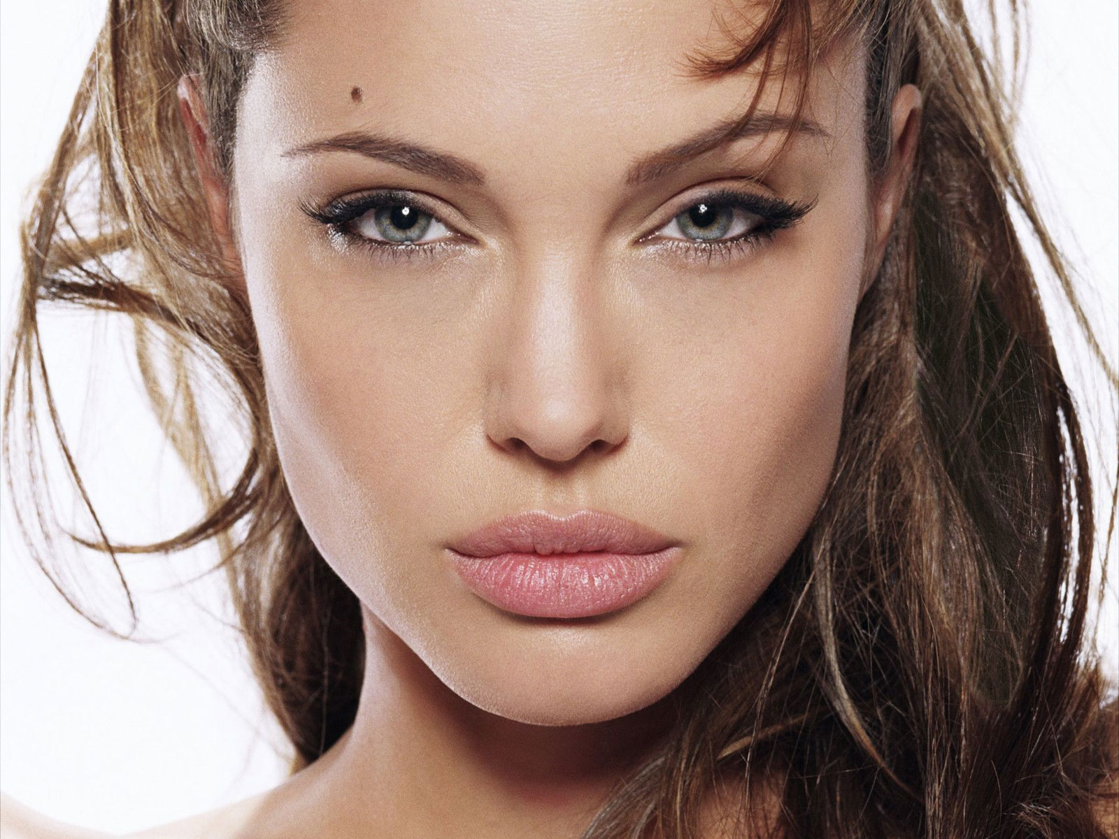 How does she keep her iconic lips healthy? She uses Blistex, a lip balm brand