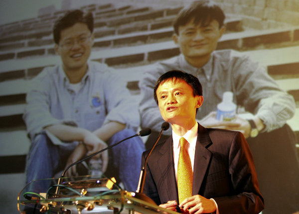 Ma at the Alibaba global coming-out party in August 2005, with a photograph in the background of Jerry Yang, left, of Yahoo and Mr. Ma.