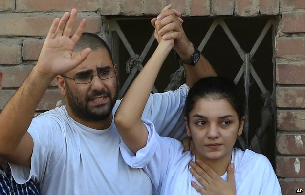 Prominent blogger Alaa Abdel-Fattah who was jailed for violating the protest law and subsequently released, and his sister Sanaa Seif who is among the 23 newly sentenced