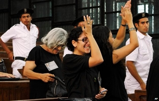 Sanaa Seif (wearing glasses) celebrates in September as her brother Alaa was released on bail