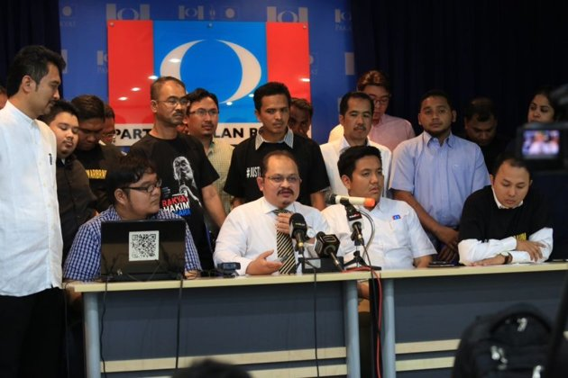 PKR Vice-president Shamsul Iskandar Mohd Akin (seated 2nd left) holds a press conference during the launching of #Justice4AnwarIbrahim at the PKR headquarters, October 27, 2014.
