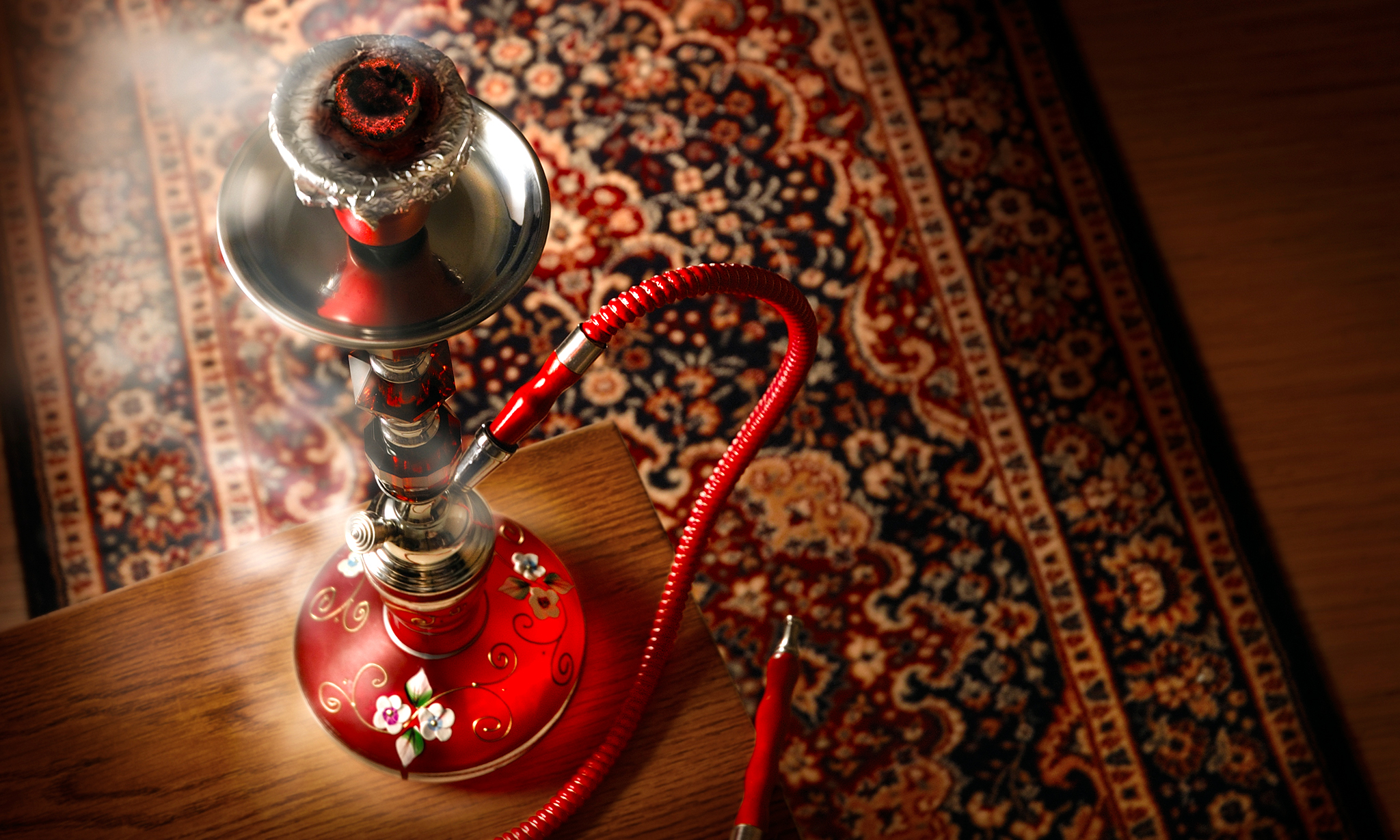 "For the uninitiated, shisha is a ""glass-bottomed water pipe in which flavoured tobacco is covered with foil and roasted with charcoal."" The smoke is passed through the water chamber and is inhaled into the lungs slowly."