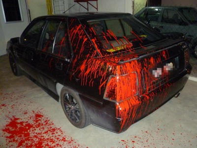 """If you don't collect your money, we spray your car with paint!"". Picture for illustration purposes only."