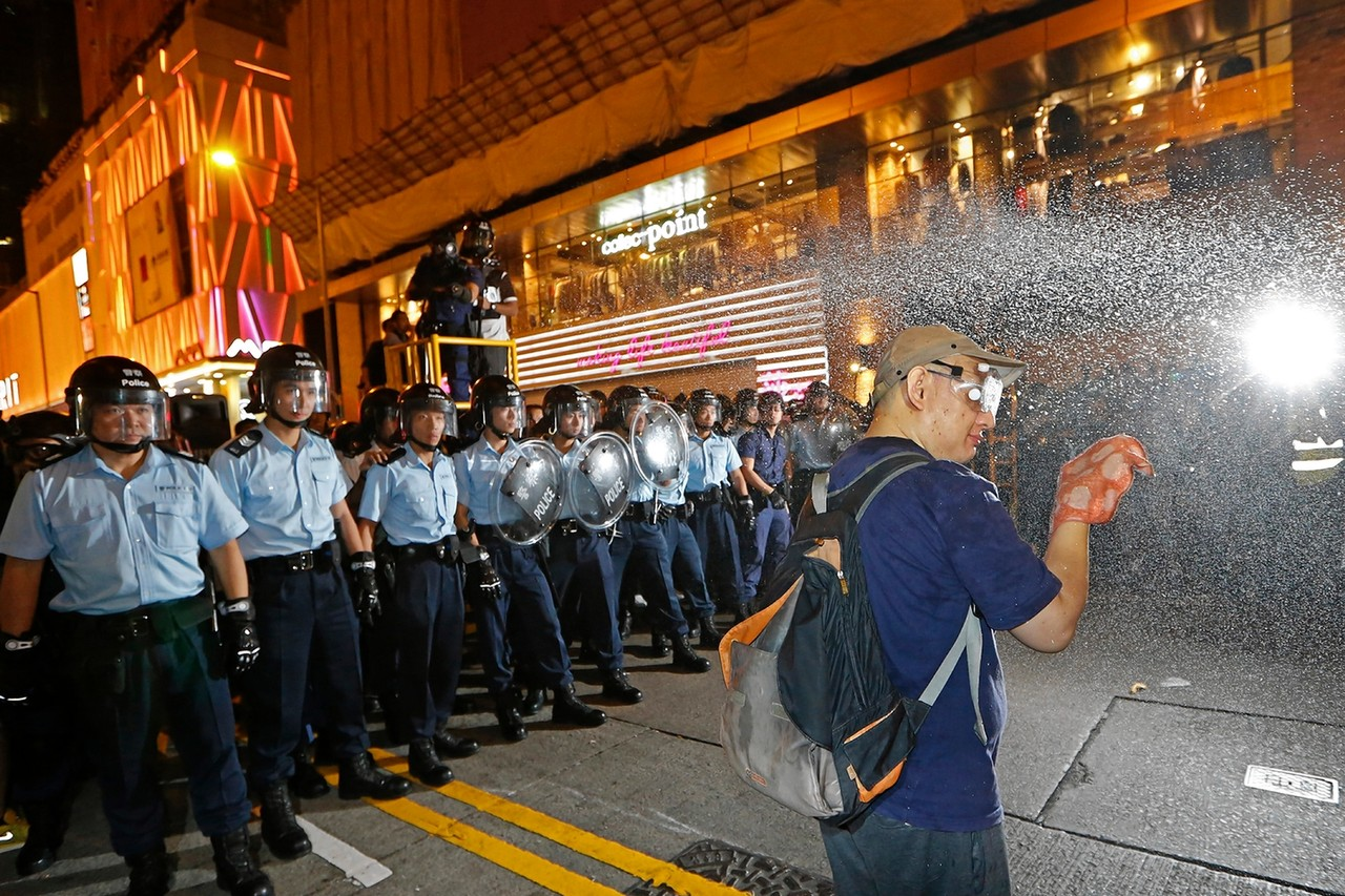 Police deployed pepper spray after demonstrators refused to clear a section of the Mong Kok site