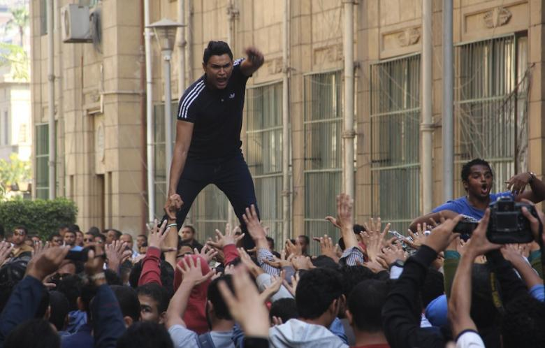 Students of Cairo University march during an anti-coup protest in Cairo, Egypt on 17 November 2014