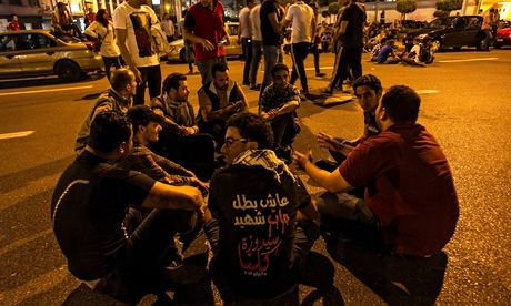 Young men demonstrate in Cairo, Egypt, against a law banning protests without prior notice