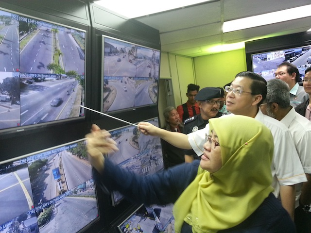 In this 15 February 2014 image, Chief Minister Lim Guan Eng, Penang Municipal Council president Datuk Patahiyah Ismail (front) and Penang police chief Datuk Abdul Rahim checking out visuals from the closed circuit televisions (CCTV) installed around Penang island under the newly-launched phase two of MPPP's CCTV system at Komtar.