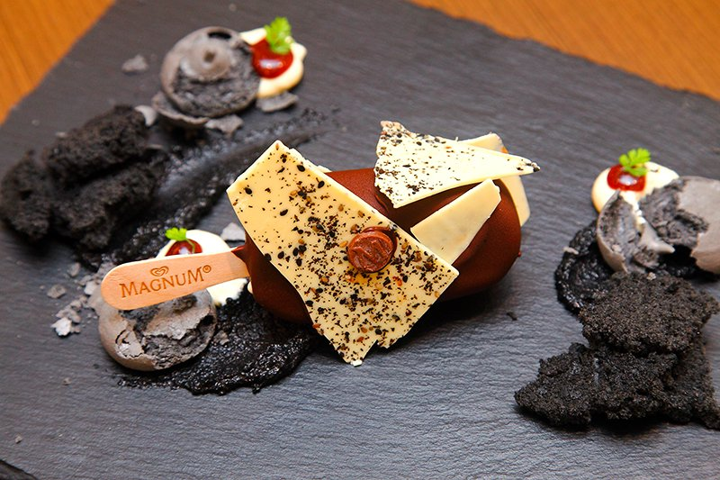Magnum Galaxy: Vanilla Magnum dipped in both white and dark chocolate with shards of sesame and white chocolate sheets, then served with black sesame sponge and mascarpone cream.