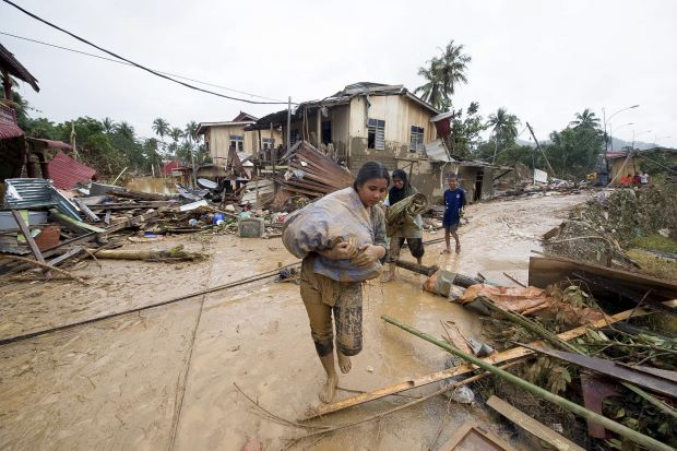 Villagers salvaging what they can in Manik Urai.