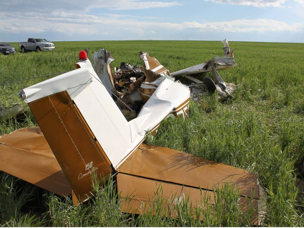 The wreckage of a crashed Cessna 150 aircraft lies in a field near Watkins, Colorado on 31 May 2014. The pilot had been taking selfie pictures with a cellphone shortly beforehand.