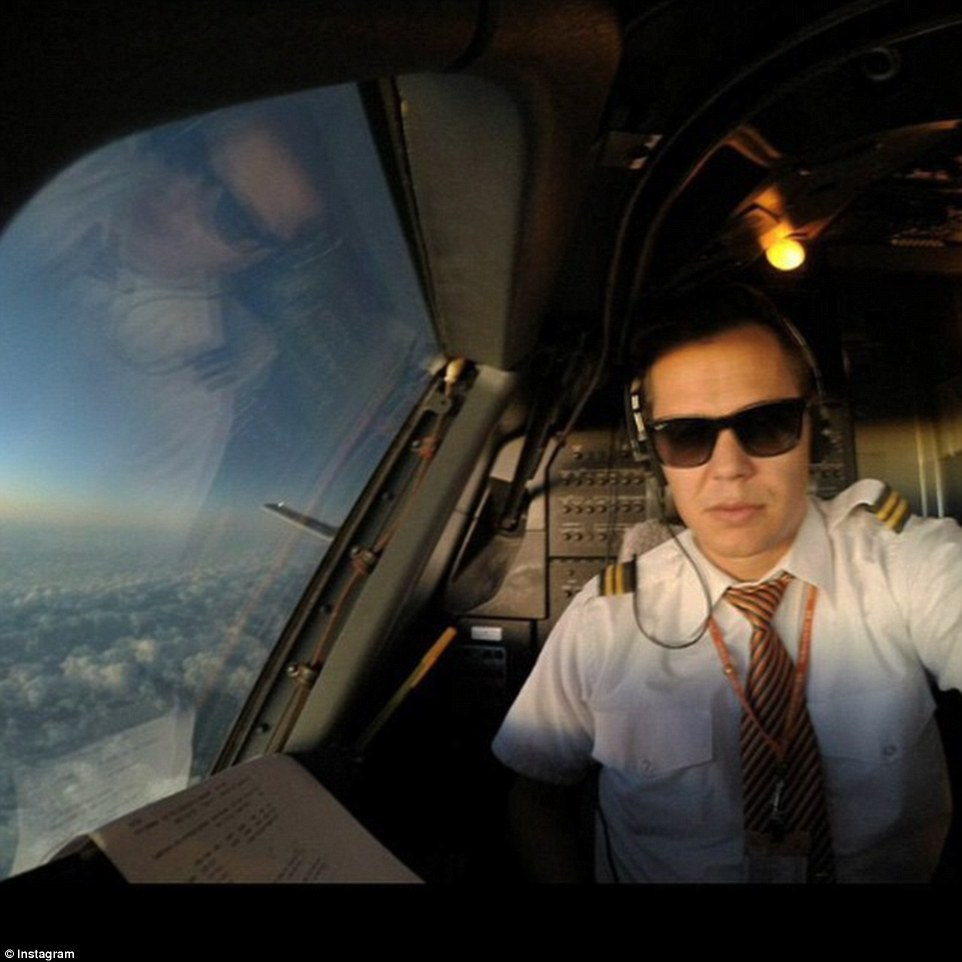 Pilots are prohibited from using most personal electronic devices, even at cruising altitude when the plane is on auto-pilot, to ensure they stay focused on flight duties, but this pilot appears to have everything under control.