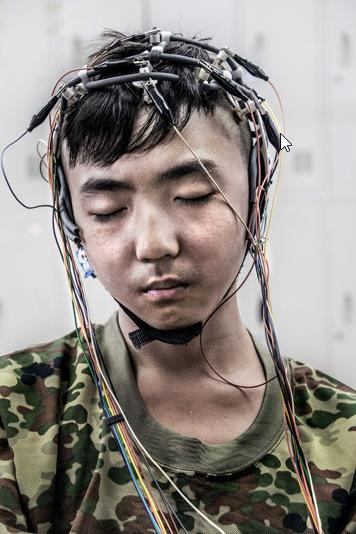 File photo of a patient at the internet-addiction treatment centre in Daxing is wired up for EEG scans to measure brain activity.