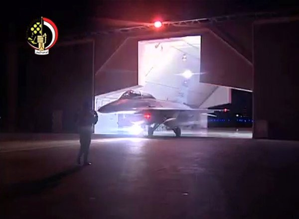 An image taken from a state-run television channel Al-Masriya broadcast after Egypt conducted airstrikes against Islamic State targets in Libya on Monday.