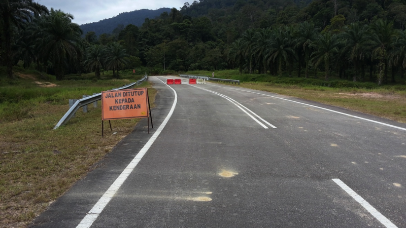 JKR has erected temporary barriers and a road closure sign.