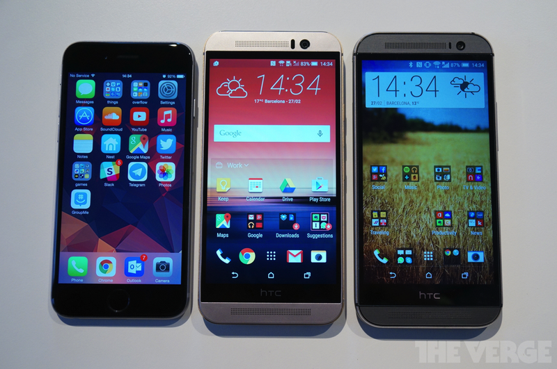 The iPhone on the left for comparison together with the HTC One M8 in the centre and the HTC One M9 on the right.