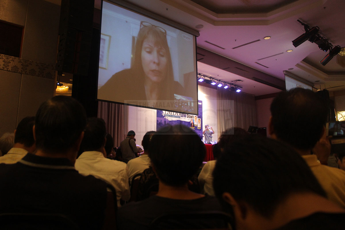 Clare Rewcastle Brown, whistleblower of the Sarawak Report addressing the audience at the '1MDB: The Ultimate LOW Down' forum at the Crystal Crown Hotel in Oetaling Jaya, 15 March via video-conference.