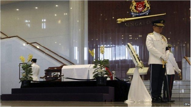 A new breed of orchid named after Lee Kuan Yew is displayed by his coffin in Parliament House.
