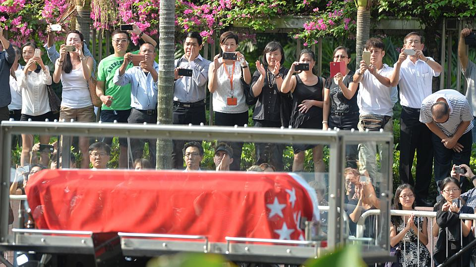 People lining the streets as the gun carriage carrying LKY's body makes its way to Parliament House.