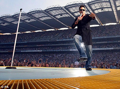 Robbie performing on stage at Croke Park in Dublin, to a crowd of 80,000 in 2006.