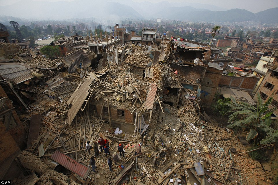 Rescue workers remove debris as they search for victims of the earthquake in the city of Bhaktapur found in the east of the Kathmandu Valley.
