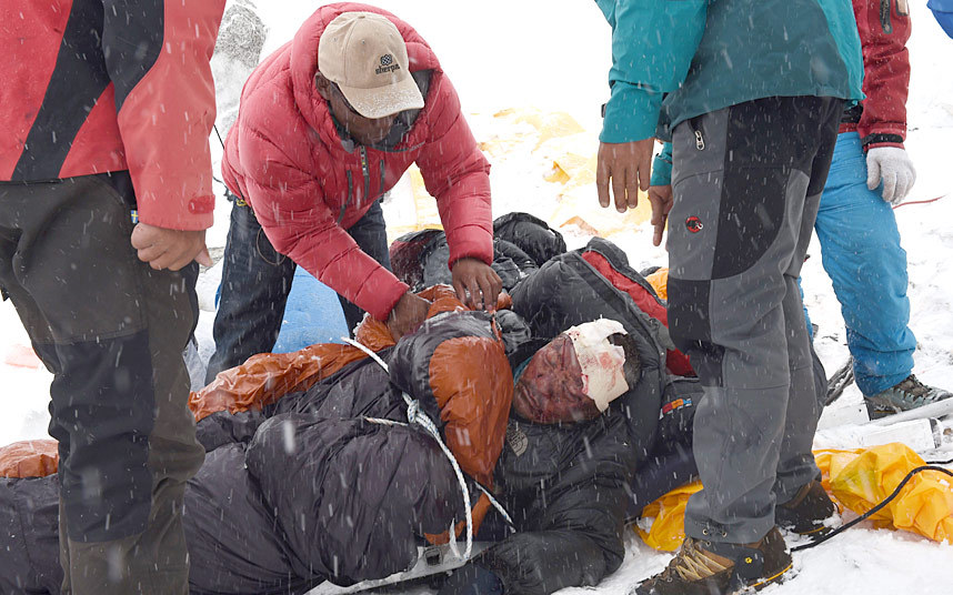 Rescuers tend to a sherpa injured in the avalanche