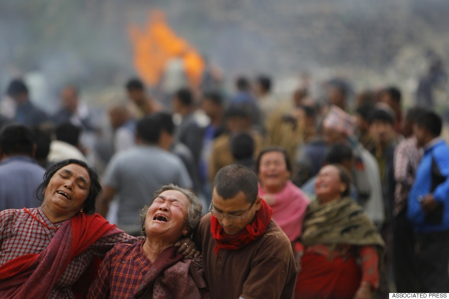 Family members break down during the cremation of earthquake victims in Bhaktapur near Kathmandu, April 26, 2015.