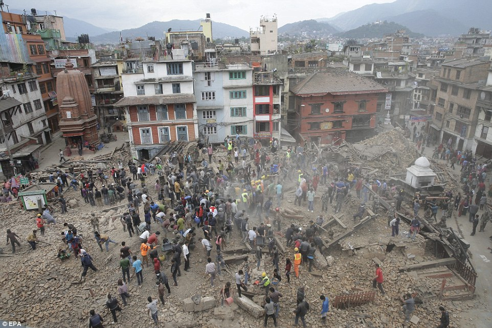 People search for survivors under the rubble of collapsed buildings in Kathmandu Durbar Square yesterday in the immediate aftermath.