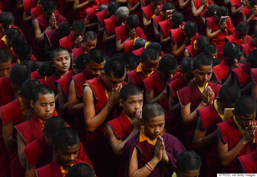 Nepalese novice Buddhist monks offer prayers for earthquake victims at the Bodhgaya Mahabodhi Temple in the Indian town of Bodhgaya on April 26, 2015.