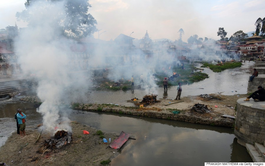 People burn the bodies of earthquake victims at a mass cremation at Pashupatinath in Kathmandu on April 26, 2015. (PRAKASH MATHEMA/AFP/Getty Images