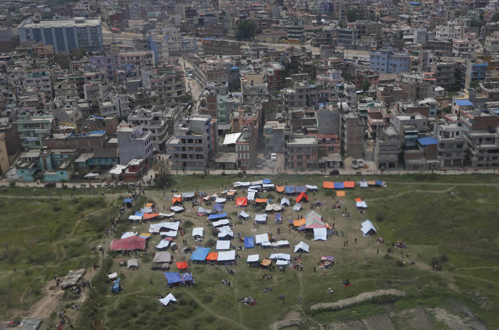 Tents are seen from an airplane window in an open field next to Tribhuwan International Airport on April 26, 2015, a day after a massive quake in Kathmandu, Nepal.